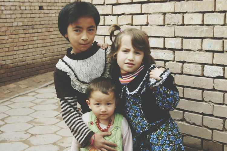 Togetherness Love Looking At Camera Beautiful Children Xinjiang Of CHINA Children Photography Children Of The World Friendship Toddler  Innocent Eyes Looking At Camera Outdoors Childhood Capture The Moment