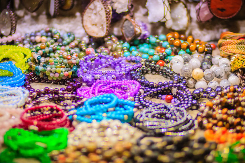 Colorful bracelets, beads and necklaces souvenir for sale on street at Khao San Road night market, Bangkok, Thailand. Khao San Rd Khao San Road KhaoSan Khaosan Rd. Khaosandroad Bracelet Jewelry Khao San Khao San Knok Wua Khao San Rd. Khaosan Road Khaosanroad Necklace Night Market