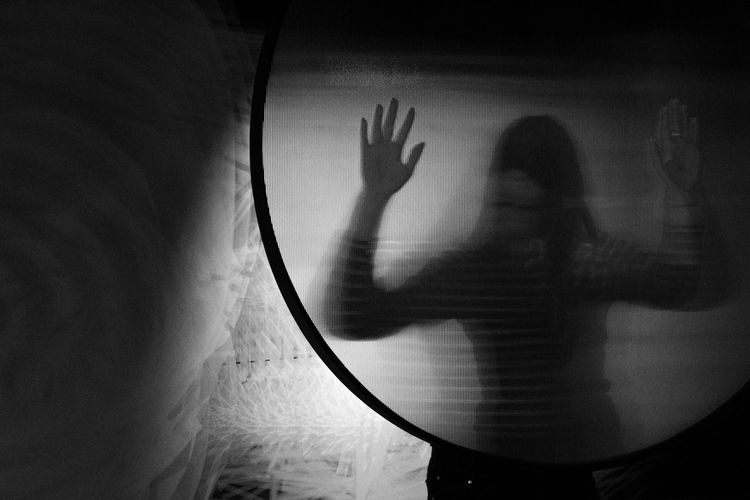 Shadow of woman hand on glass