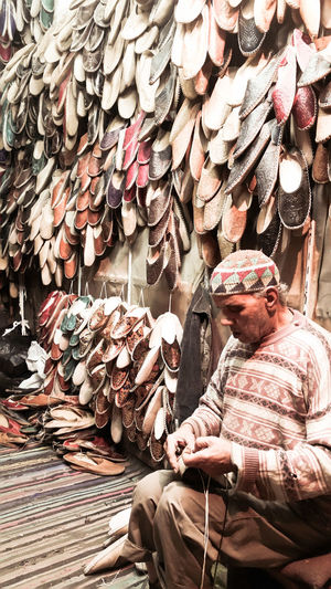 "Traditional shoe maker, called ""Baboosh"" which is the first shoe that Egyptian know. Tradition Crafts Place Of Worship Handmade For You Culture Tourism Traveling Baboosh Sheos Memory Egypt Handmade For You"