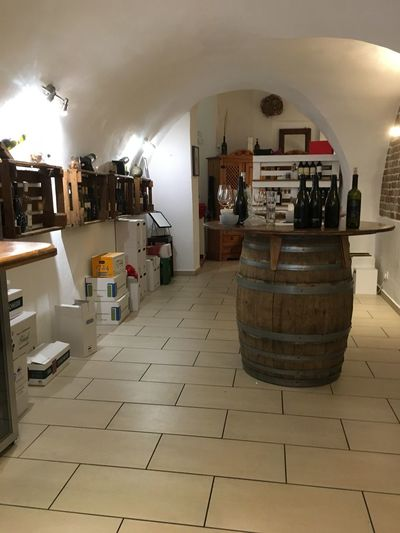 Indoors  Illuminated Barrel Business Wine Cellar Lighting Equipment Architecture Cylinder No People Flooring Wood - Material Wine Built Structure Container Domestic Room Appliance Winery Food And Drink Building Wine Cask Winemaking Tiled Floor Ceiling