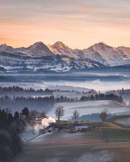 Mountain Beauty In Nature Scenics - Nature Fog Environment Sky Tranquil Scene Tranquility Landscape Sunset Non-urban Scene Mountain Range Nature No People Idyllic Cloud - Sky Tree Cold Temperature Winter Hazy  Outdoors