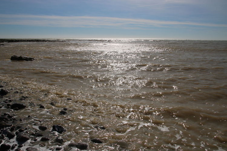 Beach Beachphotography Beauty In Nature Birling Gap Day England English Channel Horizon Over Water Nature No People Outdoors Pebbles Rocks Scenic Scenics Sea Sky Sun Shimmer On Water Sussex Tide Water Wave