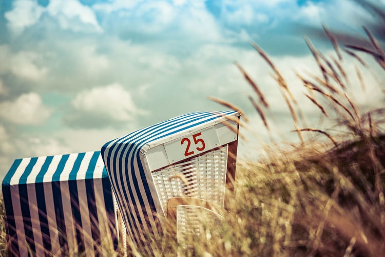 Number 25 On Hooded Beach Chair Against Cloudy Sky