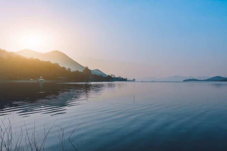 Beauty In Nature Scenics - Nature Mountain Tranquil Scene Tranquility Water Sky Lake No People Nature Reflection Mountain Range Non-urban Scene Outdoors Land Scape Landscape Landscape Photography River View Lake View Sea View Morning Nature Dam Waterfront Sunset Idyllic Sun Clear Sky Copy Space