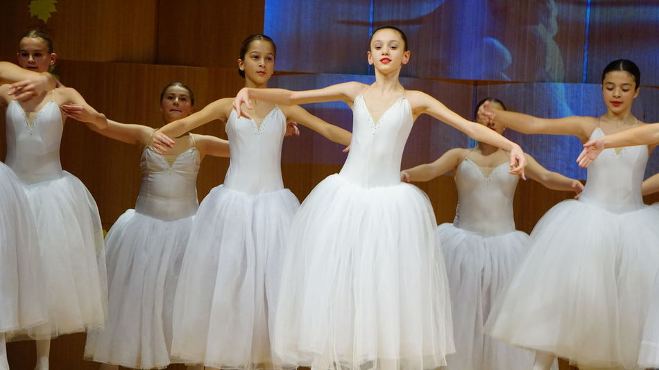 Ballet Ballet Dancer Dancing Human Arm Indoors  Looking At Camera Performance Performing Arts Event Smiling Standing Togetherness Young Women
