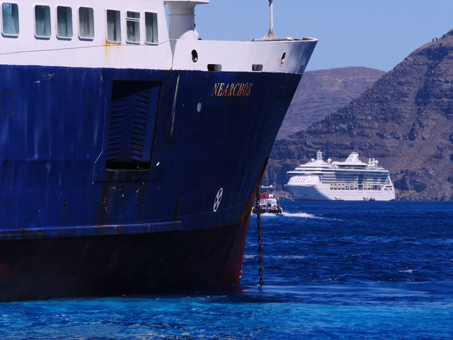 BoatsP Greek Islands Santorini, Greece Beauty In Nature Blue Boat Cargo Container Cruise Ship Day Freight Transportation Harbor Mode Of Transport Moored Nature Nautical Vessel No People Outdoors Sailing Sea Ship Sky Transportation Water Waterfront Been There BeenThereDoneThat Ferry