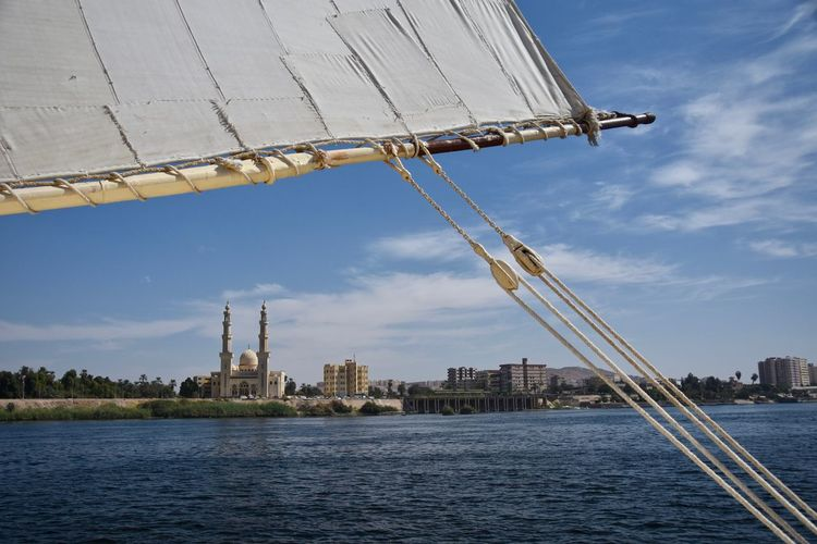 Mosque by river nile against sky