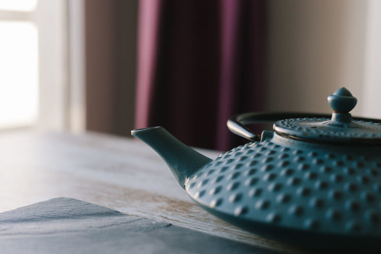 Tea Tea - Hot Drink Tea Time Tea Pot Teapot Infuser Iron Iron - Metal Kettle Blue Table Wood - Material Indoors  Still Life Close-up No People Pattern Ceramics Household Equipment Day Food And Drink Refreshment Crockery Focus On Foreground Kitchen Utensil Tea Kettle Tablecloth Floral Pattern