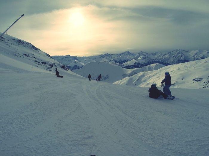 People Snow Boarding On Landscape