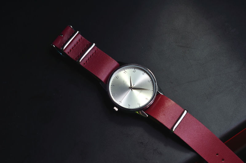 red watches with selective focus Isolated Leather Red Backgroud Black Clock Close-up Jewelry Silver  Watches Wristwatch Be. Ready. EyeEmNewHere Black And White Friday See The Light Modern Workplace Culture The Still Life Photographer - 2018 EyeEm Awards