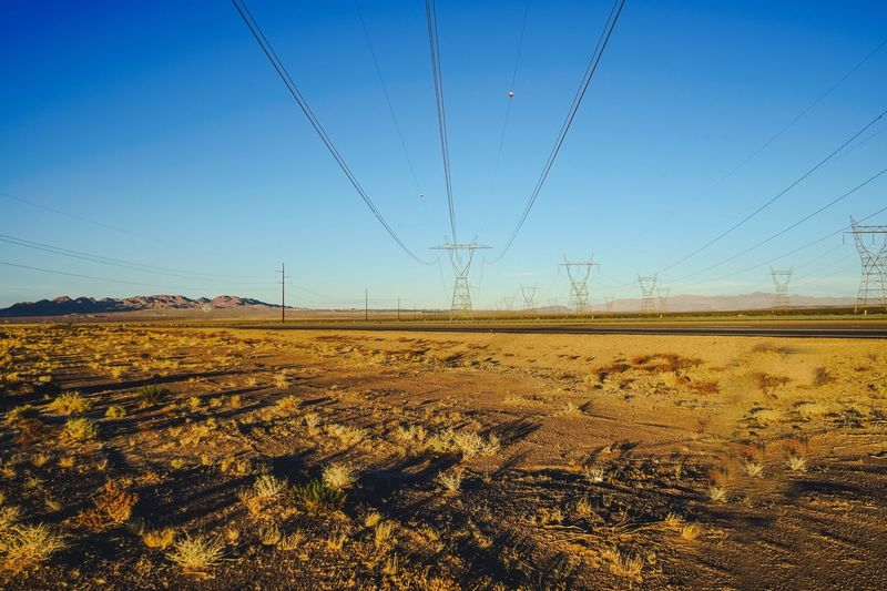 Nevada desert outside of Las Vegas late afternoon shot with a Sony A7 camera and lens Road To Nowhere Desert Life Desert NEVADA, USA!♡ Day No People Power Line  Power Supply Electricity Pylon Electricity  Outdoors Agriculture Blue Tranquil Scene Sky Clear Sky Tranquility Rural Scene