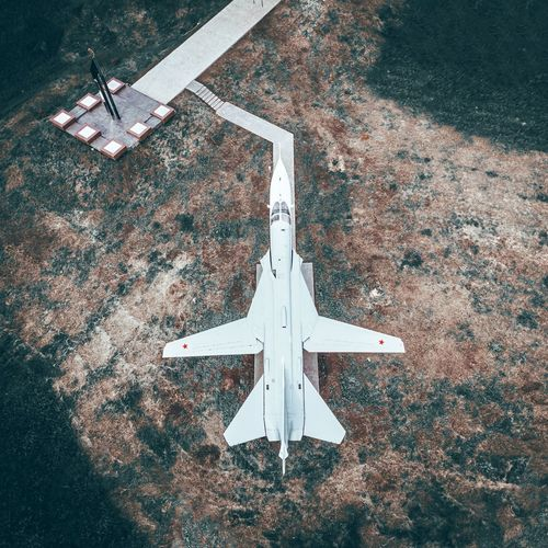 Directly above shot of airplane flying over land