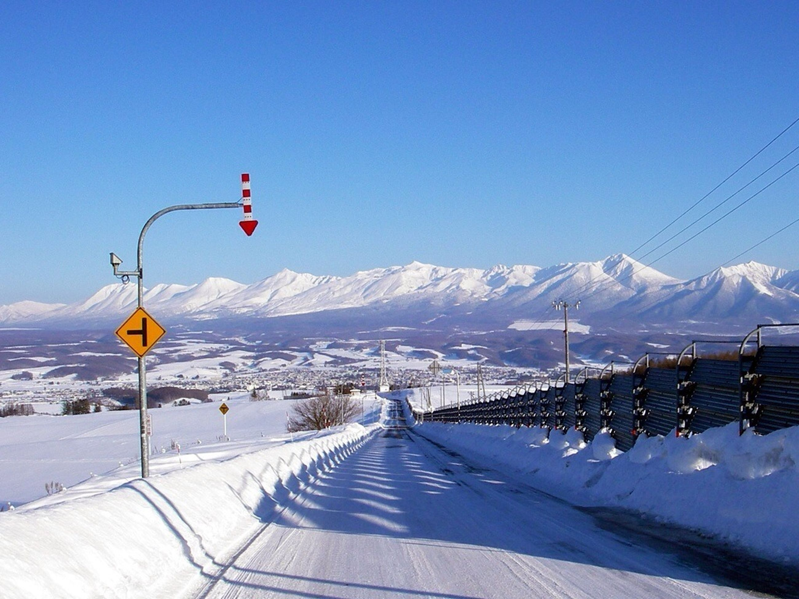 snow, winter, cold temperature, mountain, season, clear sky, mountain range, snowcapped mountain, blue, scenics, tranquil scene, tranquility, landscape, beauty in nature, weather, covering, nature, transportation, the way forward, non-urban scene