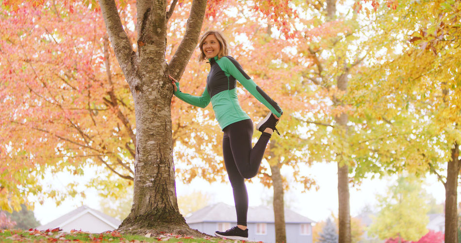 Autumn Balance Beauty In Nature Day Exercising Full Length Healthy Lifestyle Leaf Leisure Activity Lifestyles Motion Nature One Person Outdoors Park - Man Made Space Real People Smiling Sports Clothing Sunlight Tree Tree Trunk Vitality Women Young Adult Young Women