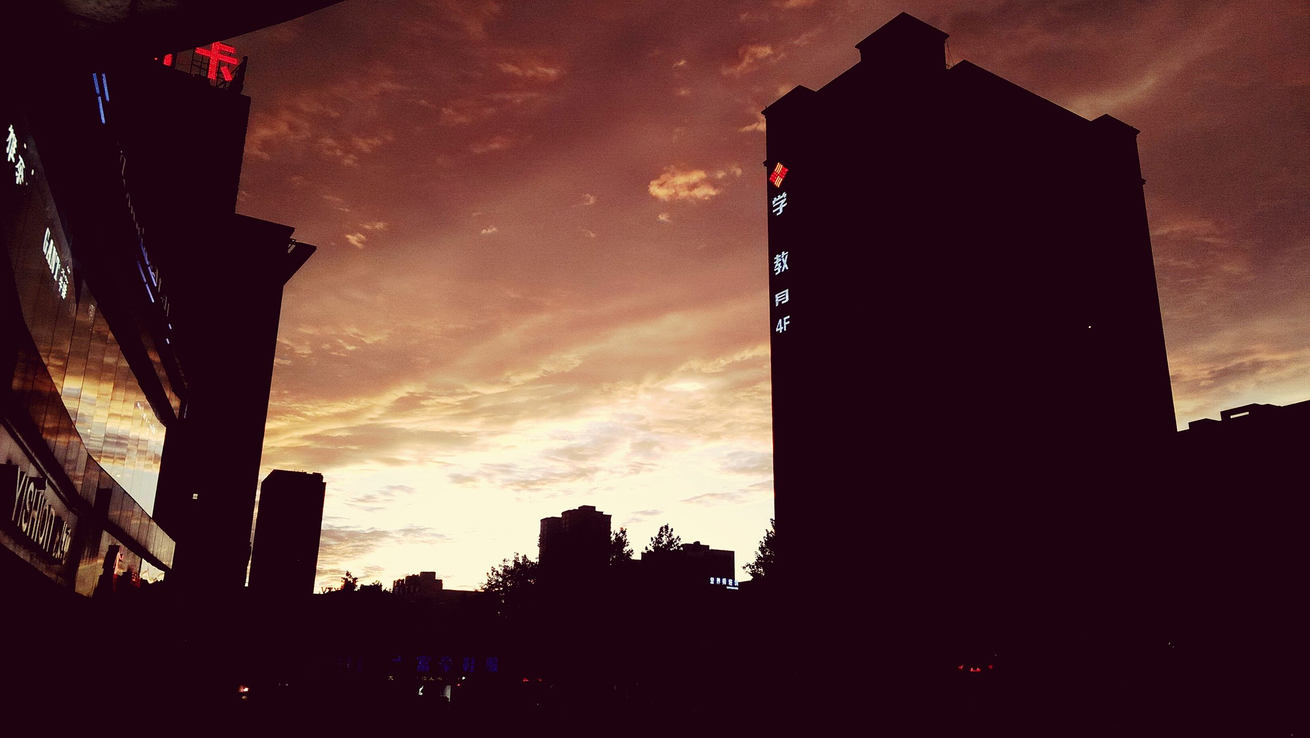 silhouette, building exterior, architecture, built structure, low angle view, sky, sunset, city, building, dusk, dark, cloud - sky, outdoors, outline, street light, cloud, no people, tower, residential building, residential structure