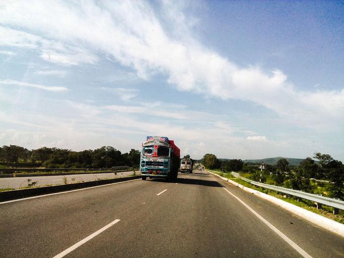 Semi-Trucks On Highway Against Sky