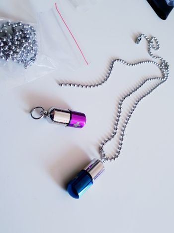 Pendants Pendant Container Club Activities Club Accessorie Drug Container Necklace White Background Make-up Studio Shot Nail Polish Pink Color High Angle View Close-up Jewelry Beauty Product Mascara