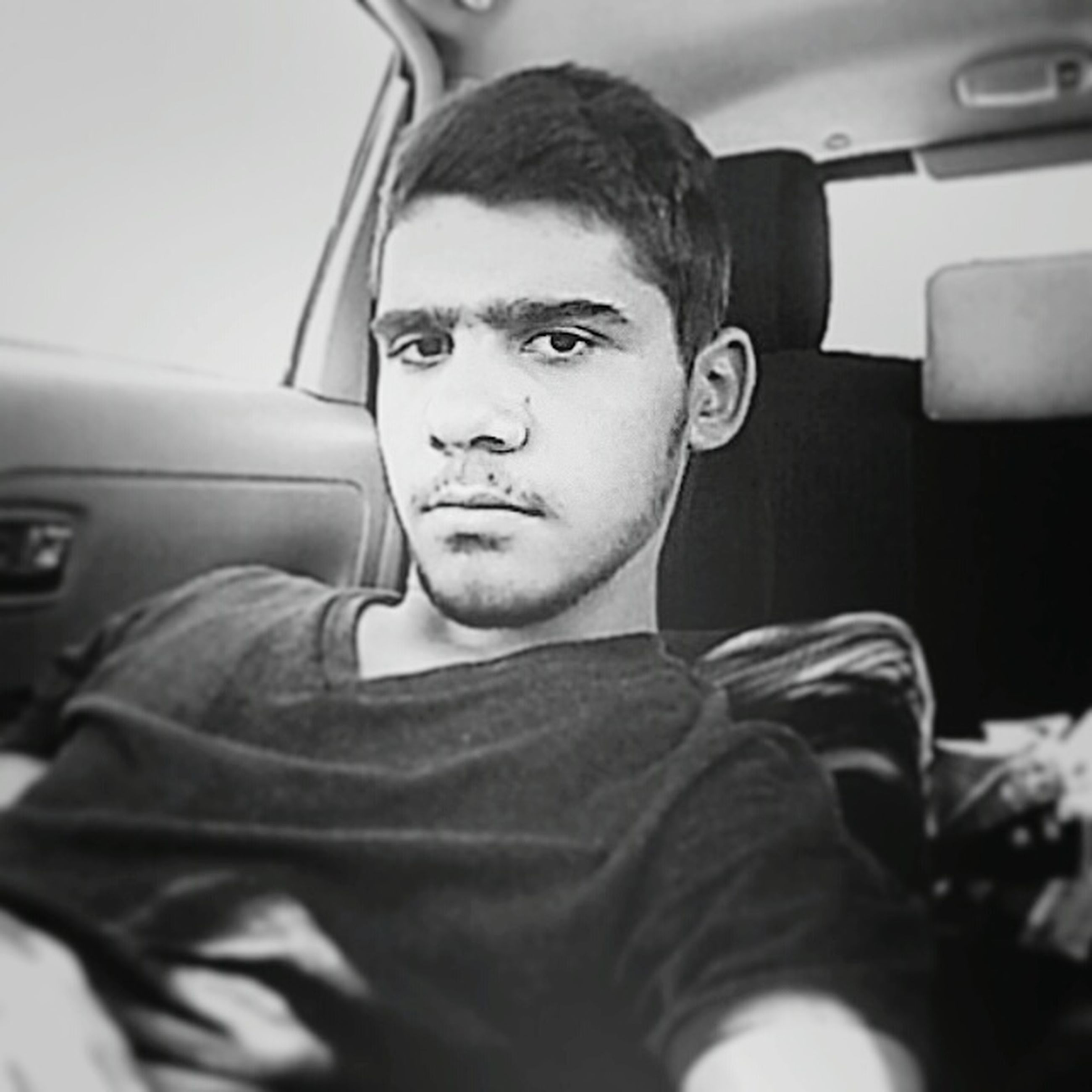 transportation, vehicle interior, indoors, lifestyles, headshot, portrait, mode of transport, looking at camera, car, person, land vehicle, young men, leisure activity, casual clothing, front view, young adult, car interior, close-up
