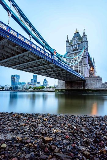 Low angle view of tower bridge over thames river against clear sky