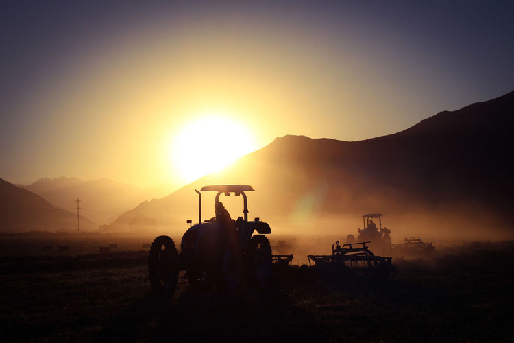 Harvest Beautiful Nature Countryside Hay Bale Hay Farmlife Hardworking Sunrise Baler Bailer Hardwork Oil Pump Sunset Occupation Working Silhouette Mountain Sky Irrigation Equipment Agricultural Machinery Agricultural Field Barley Farm Cultivated Land Bale  Tractor Farmland Agricultural Equipment Combine Harvester