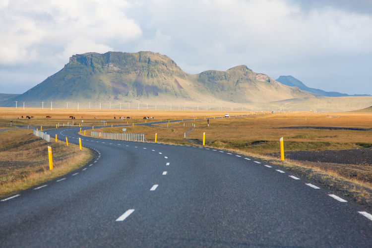Road by mountains against sky in iceland