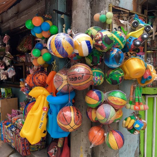 Balls and toys are displayed at a streetcorner shop in Makati, Philippines. The Shop Around The Corner Small Business Plastic Toys Balls And Toys Streetcorner Entrepreneur Entrepreneurship Children's Toys Live Love Shop Philippines