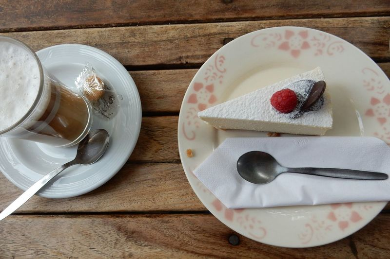 High Angle View Of Cheesecake And Coffee On Table At Restaurant