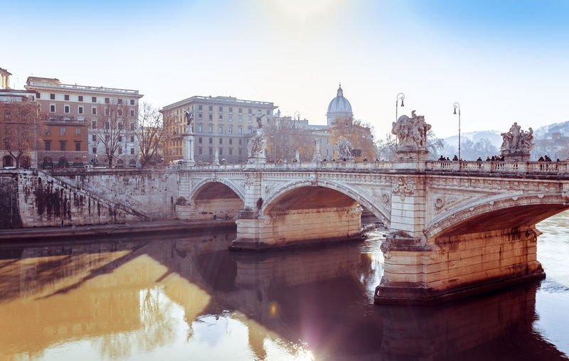 Ponte sant angelo over tiber river by st peter basilica