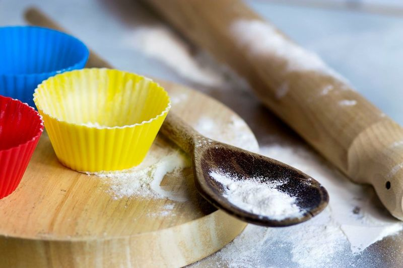 Cupcake Molds By Flour In Wooden Spoon