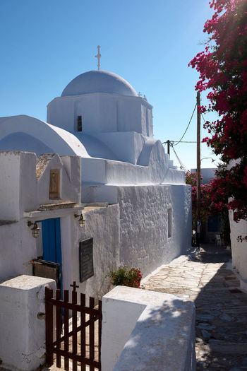 Amorgos chora Church Church Amorgos Amorgos Chora Architecture Belief Building Building Exterior Built Structure Clear Sky Cross Day Nature No People Outdoors Place Of Worship Plant Religion Sky Spirituality Sunlight White Color