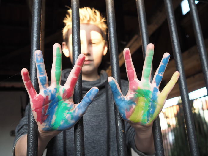 Behind Bars Color Colored Hand Colorful Colors Colour Coloured Hands Colourful Jail Lifestyles Multi Colored Prison Prisoner Regret Young Young Prisoner Teen Sadness Colours Contrast Unhappy Loneliness Home Is Where The Art Is