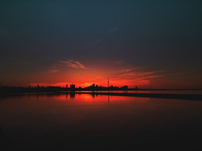 Scenic View Of Silhouette River Against Sky During Sunset