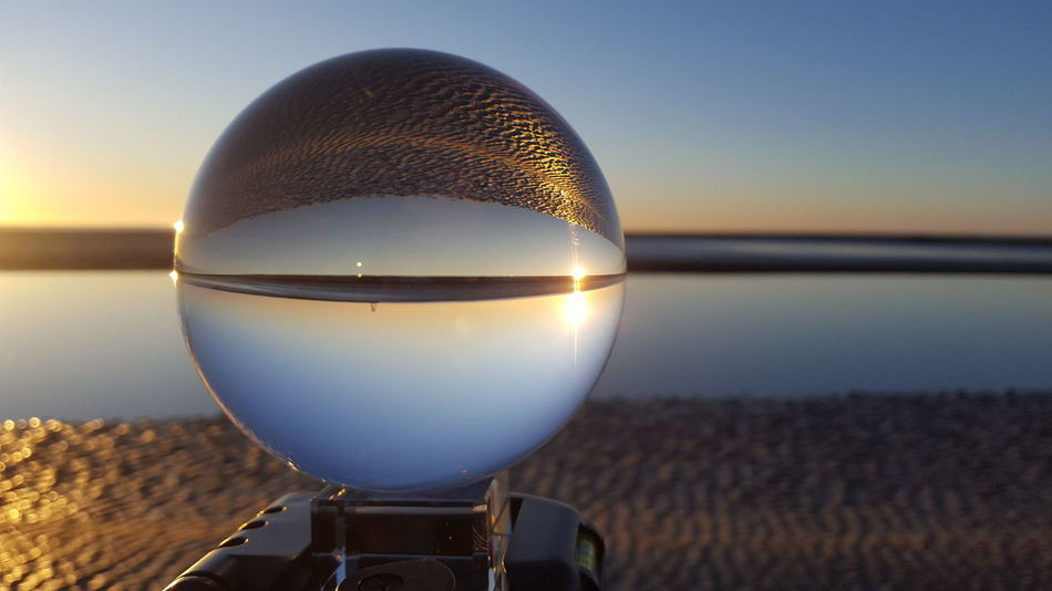Beach and Lensball EyeEmNewHere Photography Sony Northern Sea Lensball Photoart Inspiration Reflection Sunset Water Beach Dusk Sea Crystal Ball Night Arts Culture And Entertainment Close-up Refraction Sky Sand Coin-operated Binoculars Outdoors Nature Scenics
