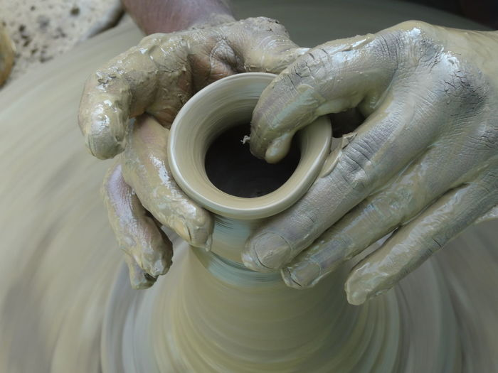 Cropped Hands Of Potter Shaping Clay