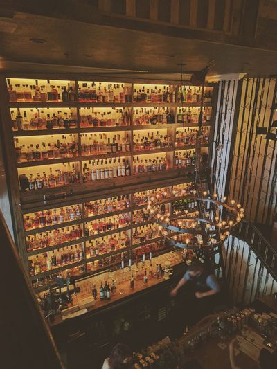 Indoors  Whiskey And Cigars Restaurants Cool Places Bar Large Group Of Objects Retail  Store Choice No People Day Close-up Supermarket Displays Vintage Style Interior Design Architecture Architecture_collection