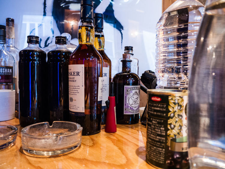 Food And Drink Indoors  Table Large Group Of Objects Transparent Glass - Material Variation Refreshment Drink Still Life Bottle Choice Alcohol No People Focus On Foreground Wine Container Bar Counter Business Close-up Jar