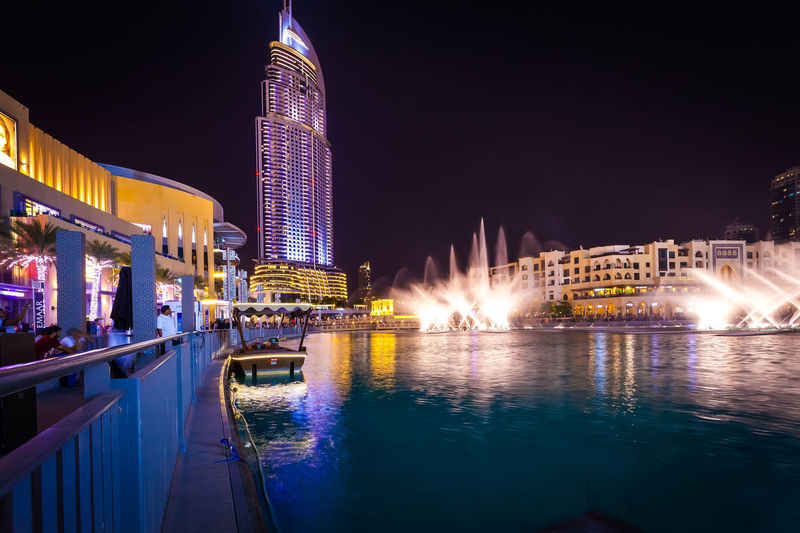 Marina Dubai Built Structure Building Exterior Architecture Night Water Illuminated City Sky Building Motion Nature Travel Destinations Reflection Office Building Exterior Waterfront Skyscraper Tall - High River Tourism No People Modern Spraying Outdoors Luxury