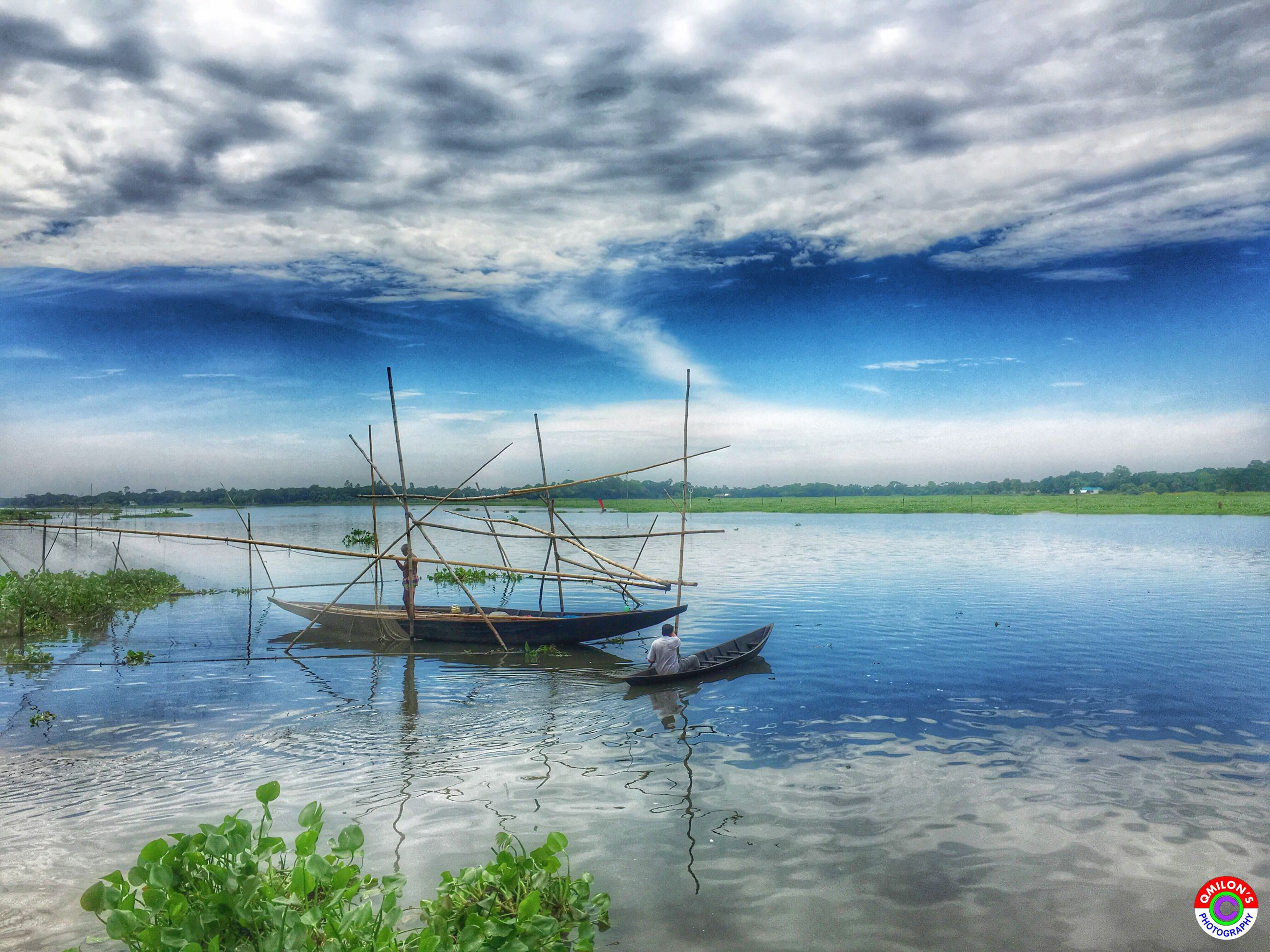 water, transportation, nautical vessel, sky, tranquility, tranquil scene, scenics, cloud - sky, mode of transport, lake, cloud, calm, nature, blue, sea, plant, beauty in nature, day, cloudy, cloudscape, non-urban scene, seascape, outdoors, no people, dramatic sky, ocean, cumulus cloud, tourism
