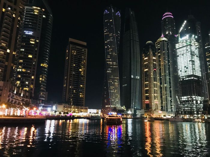 Connected By Travel Building Exterior Night Architecture Built Structure Illuminated Water Skyscraper Tall - High City Modern Tower Travel Destinations Waterfront Outdoors Cityscape Urban Skyline Tadaa Community Theholysin Dubai Dubaimarina