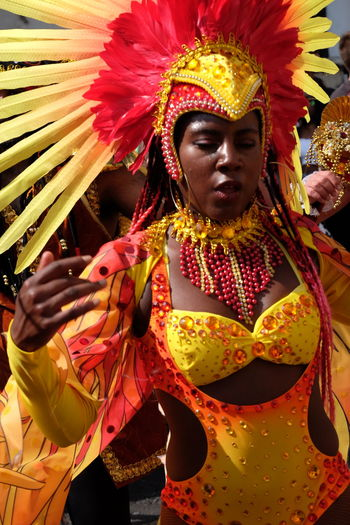 Dancer, Paraiso School of Samba Carnival Composition Dancing Feathers Fun GB London Paraiso School Of Samba Samba Beautiful Woman Capital City Carnival Costume Close-up Dancer Front View Full Frame Headress No Incidental People Nottinghill Carnival 2017 One Person Outdoor Photography Red And Yellow Colour Uk Waist Up Young Woman
