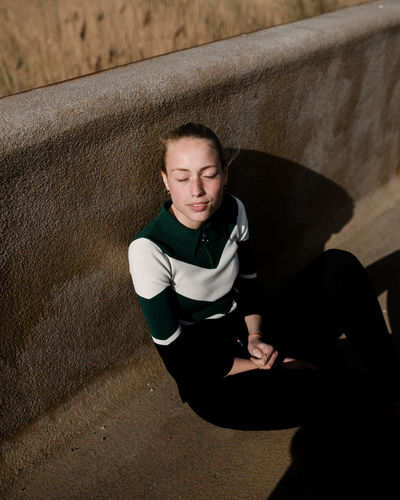 Emilie Randløv of Scoop Models Portrait Portrait Of A Woman Portrait Photography Model Scandinavia Denmark Beautiful Woman Sunlight Sunshine Light Light And Shadow Sitting Shadow Full Length Sunlight Relaxation High Angle View Exercising Sport