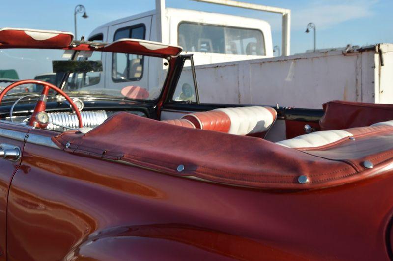 Red Vintage Car In Parking Lot