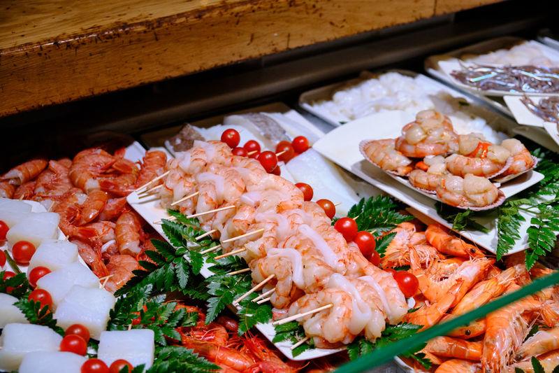 High angle view of food on plates at tapas bar