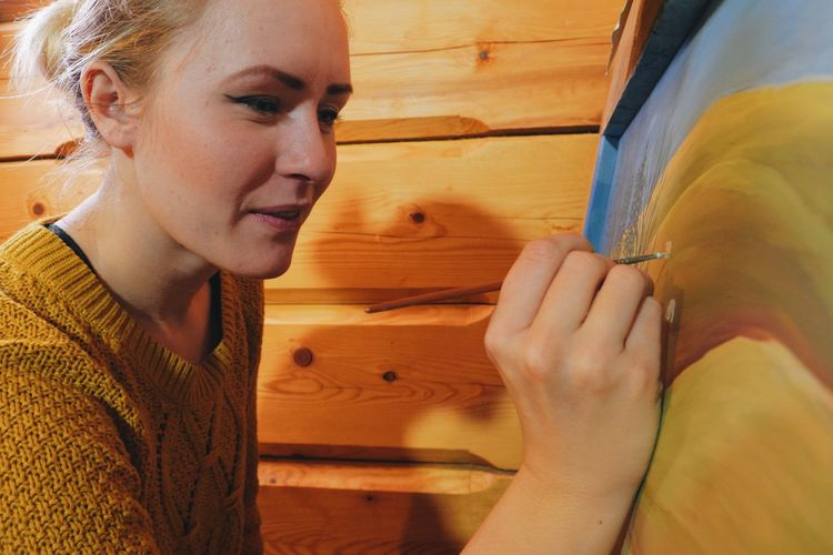 Close-Up Of Young Woman Painting