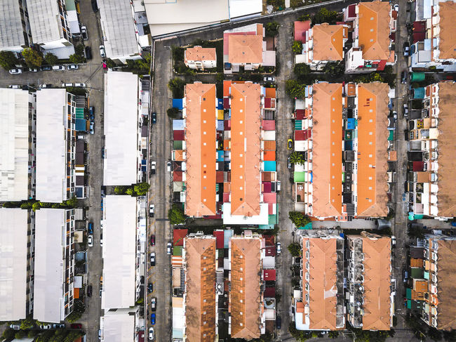 Colorful house roofs in dense, top view Aerial View Architecture Building Building Exterior Built Structure Cargo Container City Container Day Directly Above Freight Transportation High Angle View Industry Land Vehicle Mode Of Transportation Motor Vehicle No People Outdoors Roof Transportation