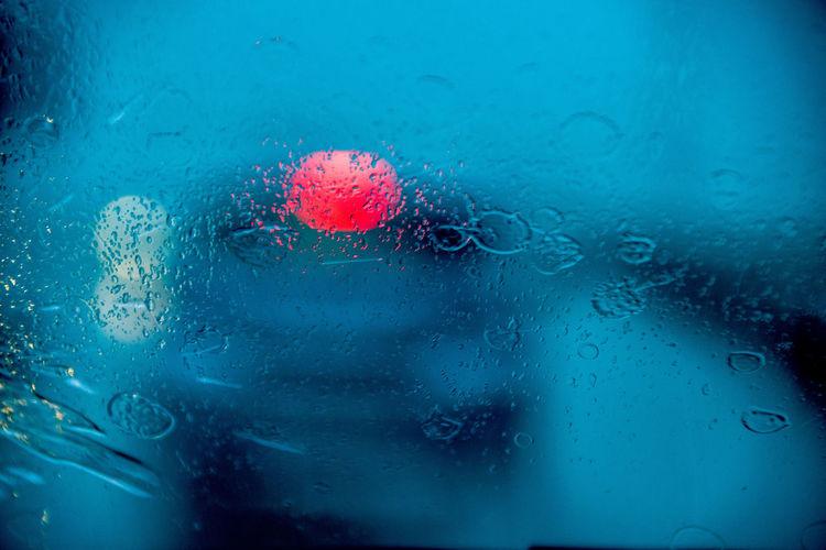 Full frame shot of wet windshield during rainy season