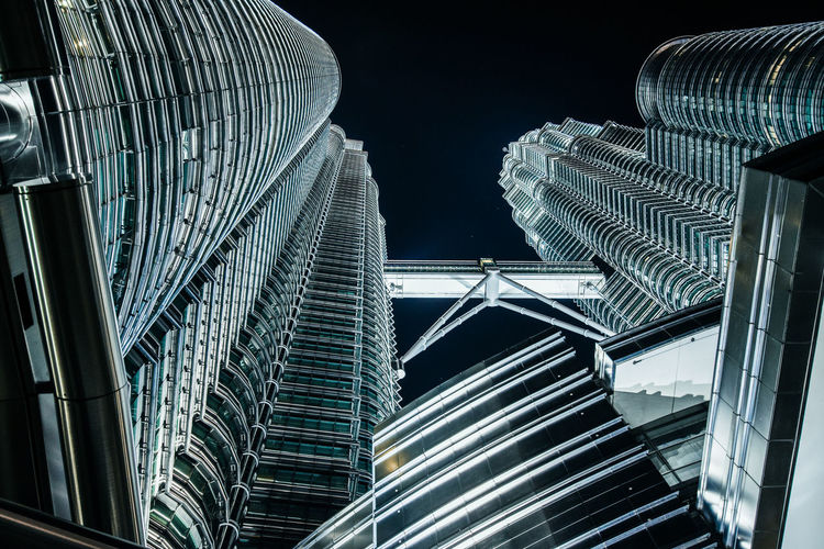 Petronas Twin Towers Illuminated Iconic Architecture Modern City Skyscraper Night Futuristic Tall - High Travel Destinations Financial District  Glass - Material Steel And Glass Travel Office Building Exterior Low Angle View No People Office Outdoors Tower Twin Towers