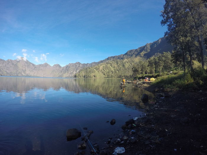 Rinjani Mountain, Lombok, Indonesia Agushariantophotography Beauty In Nature Blue Clam Day Idyllic Lake Mountain Nature No People Outdoors Reflection Rinjani Mountain Scenics Segara Anak Lake Sky Tranquil Scene Tranquility Tree Water