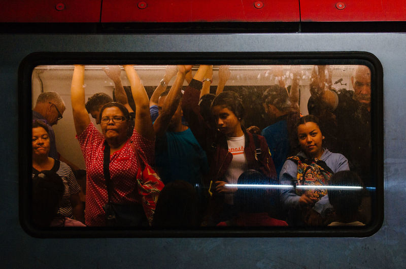 The great party! Mode Of Transportation Group Of People Women Public Transportation Lifestyles Transportation Communication Window Real People Men Glass - Material Wireless Technology People Technology Indoors  Transparent Adult Portrait Smiling Young Adult EyeEm Best Shots EyeEm Selects Capture Tomorrow The Art Of Street Photography The Street Photographer - 2019 EyeEm Awards